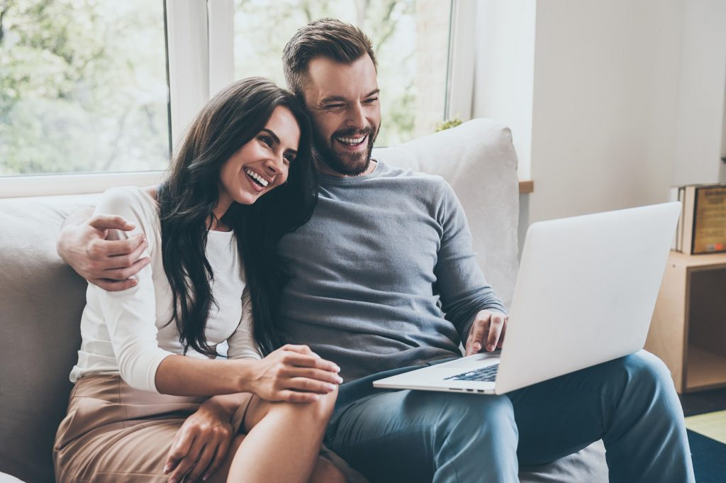 Expats with laptop in online mortgage call
